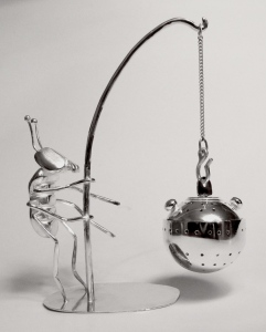 Close up of Fishing Fred with round tea infuser